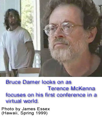 Bruce Damer looks on as Terence McKenna focuses on his first conference in a virtual world.